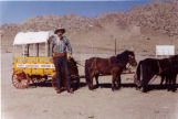 Small scale wagon with team of horses and driver