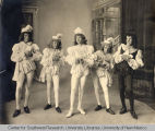 Group portrait of five children in the costume of courtiers or pages