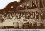 Group portrait of an evening banquet