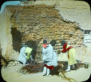 Women re-plastering house at San Felipe Pueblo, NM