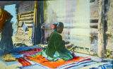 Navajo woman weaving blanket
