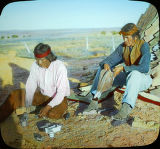 Two Navajo silversmiths making jewelry