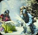 Apache women making baskets