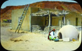 Unidentified Pueblo woman baking bread
