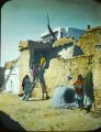 Acoma Pueblo women climbing down ladder