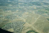 Aerial photograph of patterns in the landscape, residential development gradually filling in J B...