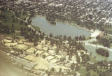 Aerial photograph of lake with city around it