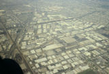 Aerial photograph of patterns of industrial/commercial against highways and residential