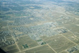 Aerial photograph, showing; fields, road divisions, suburbia and urbanization filling in