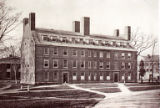 Newsprint image of a four-story college building