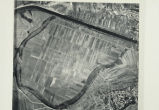 Aerial photograph of fields adjacent to a hard lined irrigation canal, remains of forested area...