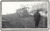 Man standing in front of a bulldozer