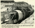 View of formwork and supporting structure for large water pipe, from Canals - Navajo Indian...