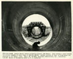 View of man welding lining in large water pipe, from Canals - Navajo Indian Irrigation Project,...