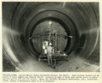 Sandblasting steel lining of water pipe interior from Canals - Navajo Indian Irrigation Project,...