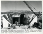 Concrete pour of the floor slab at pipe inlet from Canals - Navajo Indian Irrigation Project, New...