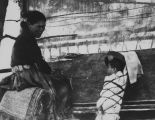 Navajo Woman Weaving, with Child