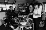 Julia Little, Loraine Keedinihi (Kataney) and Cindy preparing feast in Zani Keediniihi's Hogan,...