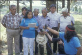 Hopi woman reading press statement; Hopi Dine  Neighborship Conference