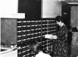 Charlemaud Curtis at card catalog