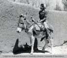 Boy Riding Donkey