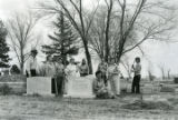 Women cleaning a cemetery in Simla, Colorado, 1977