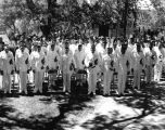 Commencement - men in Naval dress uniform outdoors