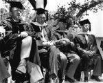 Commencement - four Honorary Degree recipients sitting