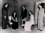 Dangerous Corner - scene from play - two women seated, three men standing
