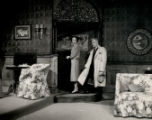 Separate Tables - scene from play - man and woman in doorway