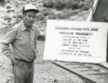 Harding Pegmatite mine - Gilbert Griego and stenciled sign