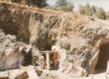 Harding Pegmatite mine - chute, man at shack, mine entrance with tracks