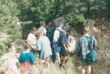 Harding Pegmatite field trip - group of eight in dry stream bed