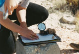 Harding Pegmatite field trip - clipboard, minerals, and compass
