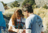 Harding Pegmatite field trip - man and woman examining mineral