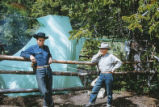Harding Pegmatite mine - two men leaning on fence