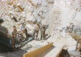 Harding Pegmatite mine - four men at bottom of chute