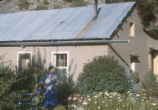 Harding Pegmatite mine - woman in garden in front of house