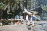 Harding Pegmatite mine - man in hat sitting at campsite