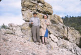 Harding Pegmatite mine - man and woman in front of rock formation