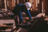 Dormitory - Redondo Village - construction - worker hammering