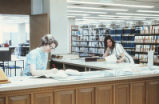 Library - Zimmerman - interior - employee and patron at service desk