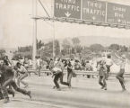 Anti-war protest - students running onto Interstate 25