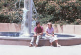 Landscaping - fountain - Education Complex - man and woman seated