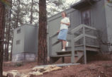 D.H. Lawrence Ranch - woman on steps of cabin