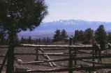 D.H. Lawrence Ranch - fence, saddle, and mountains