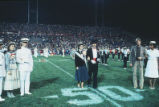 Homecoming - band and royalty on football field