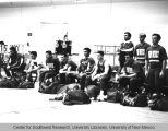 Athletics - UNM Lobos Men's Gymnastics Team - with duffel bags