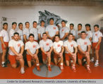 Athletics - UNM Lobos Wrestling Team posed in wrestling room