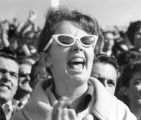 Student Publications - cheering crowd, woman in glasses